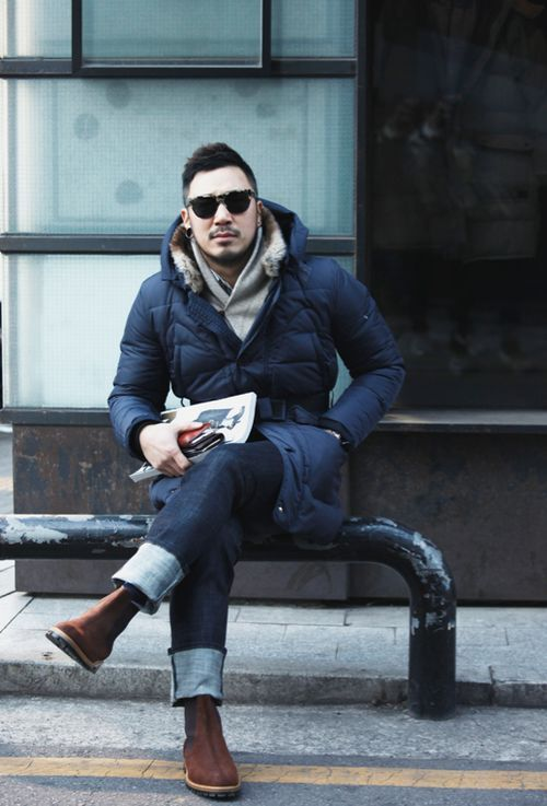 Shop this look on Lookastic:  http://lookastic.com/men/looks/scarf-parka-jeans-chelsea-boots-sunglasses/4973  — Grey Scarf  — Navy Parka  — Navy Jeans  — Dark Brown Nubuck Chelsea Boots  — Black Sunglasses