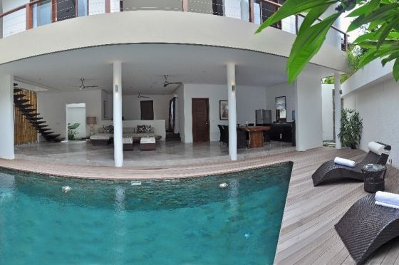 This Bali Private Villa is situated inside the chic district of Seminyak. Located just back from Seminyak vast expansive beaches, an ideal location to absorb Bali's boutiques, excellent restaurants and spas. The villa is large open an ideal to relax within. The ground floor is home to the lounge, kitchen and dining area. Immediately outside is a plunge pool attractively designed and comes with sun beds.