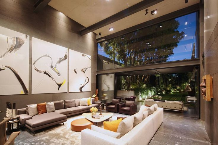 Projekty, translation missing: pl.style.salon.minimalistyczny Salon zaprojektowane przez grupoarquitectura