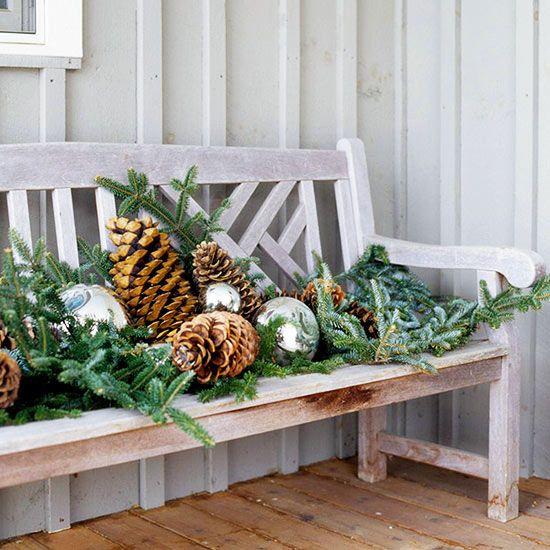 evergreens + pinecones + mercury glass balls on bench