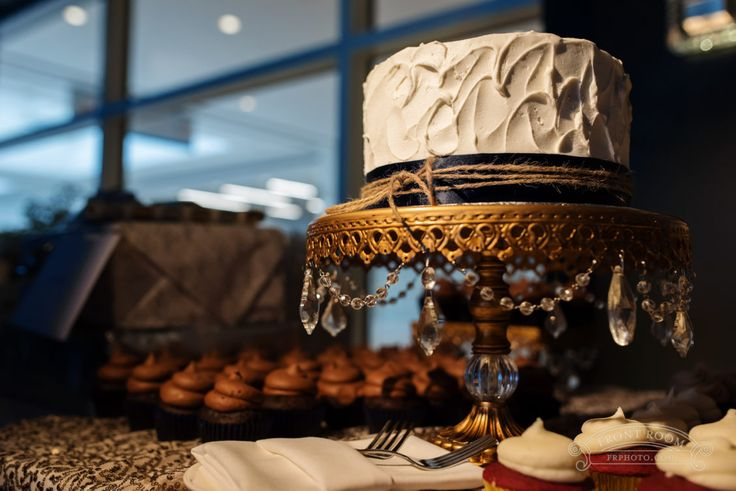 A petite buttercream cake on an antique gold cakestand with navy blue ribbon and twine, by Front Room Photography