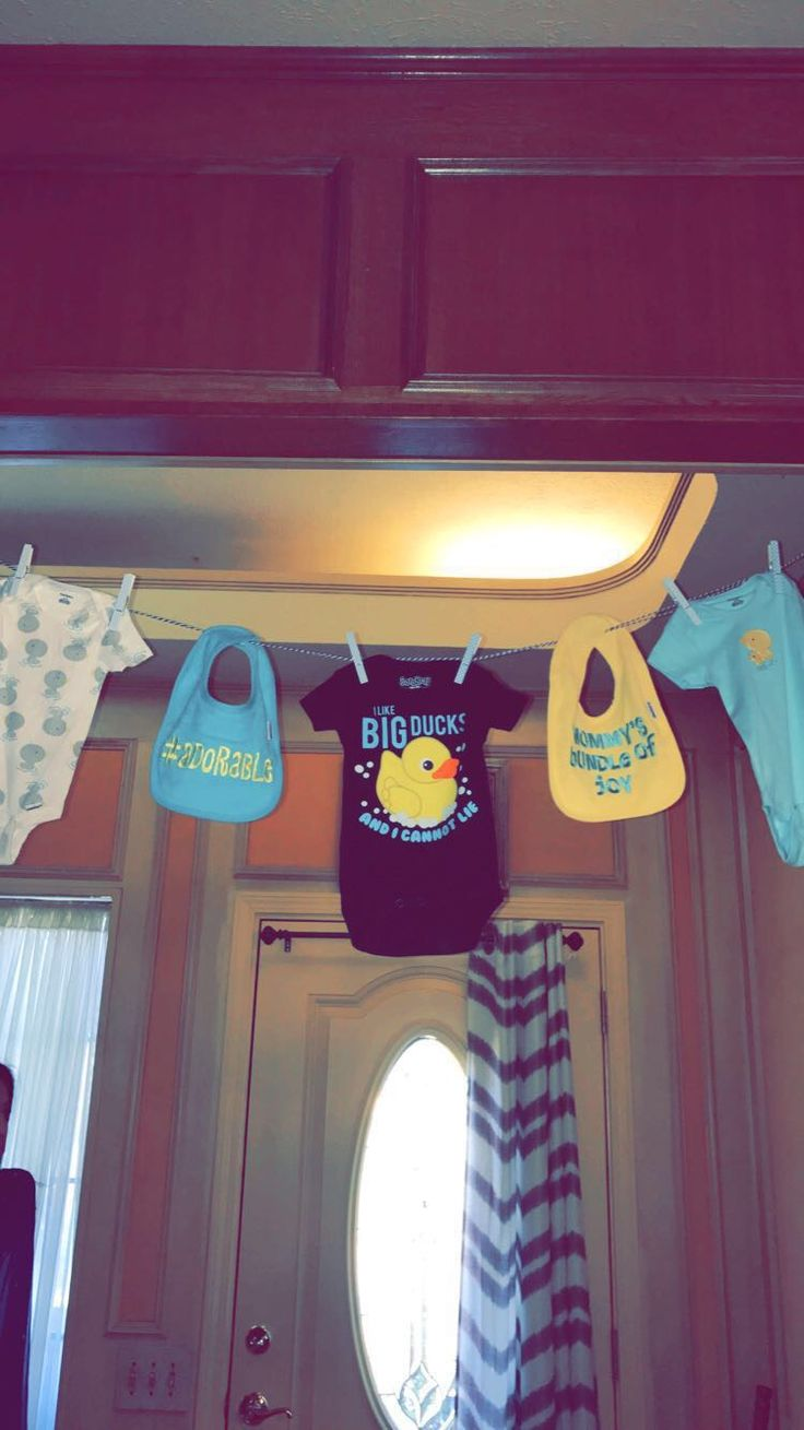 Duck themed baby shower - add themed onesies to a clothes line