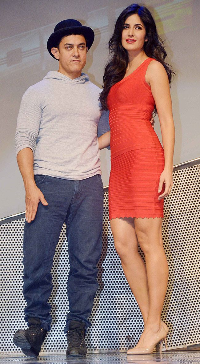 Aamir Khan and Katrina Kaif unveiled dolls based on the characters of their upcoming film 'Dhoom 3'. #Bollywood #Fashion #Style #Beauty