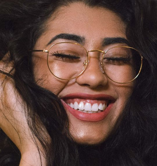 latina-with-glasses-and-facial