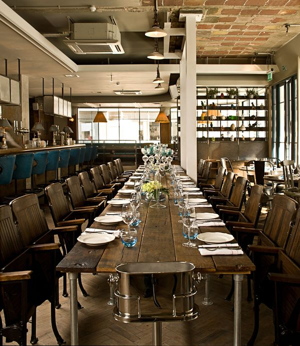 From the team behind Village East and The Garrison comes The Riding House Café, a modern all-day   brasserie that fully embraces the current trend of salvage- old wooden movie house seating & galvanized pipe table legs