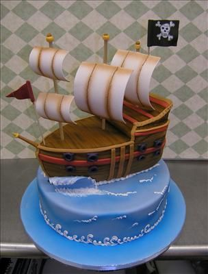Pirate boat cake. Like this one because I could make the base and the boat two different flavors. Or one allergy free.