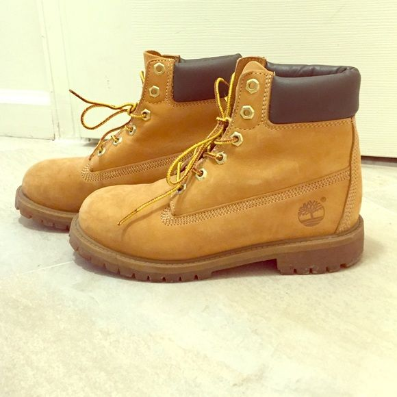 Timberland leather boots Sz 4.5 (6 in women's) Authentic Timberland Junior 6 inch premium waterproof leather boots. Worn only for a handful of times. Kept in amazing condition. Size 4.5 (equivalent to size 6-6.5 in women's). Timberland Shoes Combat & Moto Boots