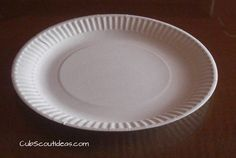 Paper plates can be used in a variety of ways at Cub Scout den or pack meetings. One fun way is to play the Paper Plate shuffle game