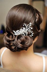 sleek with rolled curls and low side embellishment