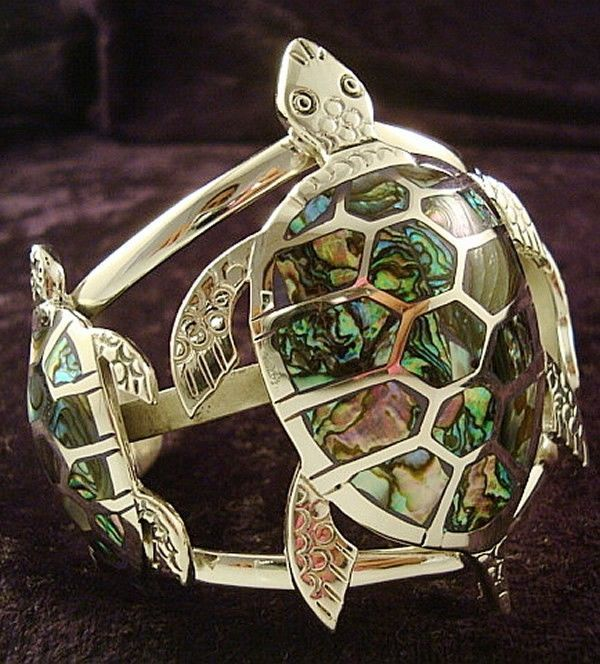 """THE 3 TURTLE PANELS OF THIS CUFF STYLED BRACELET CONSIST OF IRRIDESCENT ABALONE INLAYS, WITH THE LARGEST TURTLE PANEL MEASURING 2 3/4"""" TALL X 2"""" WIDE AT ITS WIDEST POINT - THE SMALLER PANELS EACH MEASURE 1 3/4"""" TALL X 1"""" WIDE AT THEIR WIDEST POINT. 