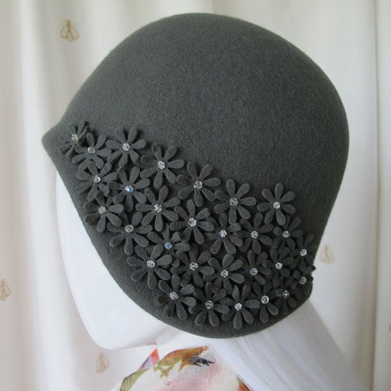Hand blocked wool felt mid grey cloche by inexplicableemporium #millinery #judithm #hats Simple lines and trim but nicely done.