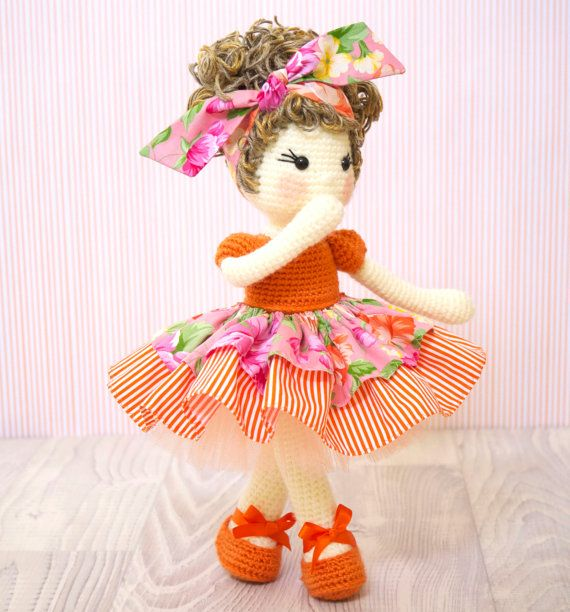 This is a finished handmade amigurumi crochet doll of a gorgeous doll called Tootie created by @petite_tini (Instagram). Tootie is a vibrant, enthusiastic ballerina girl who just has so much love to give! When she enters a room, she brings a smile to everyones face. She has on an orange leotard and matching floral and striped tutu skirt complete with a tulle petticoat under it. On her feet are a pair of orange ballet shoes. Her brown hair with golden highlights is tied up with a big hair bow…