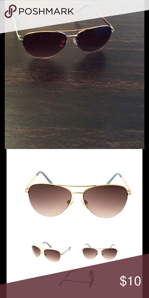 Foster Grant Sunglasses In like-new condition. Gold with aqua Foster Grant Accessories Glasses