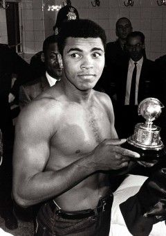 Muhammad Ali with an award presented to him after beating Great Britain's Henry Cooper who was stopped with a cut left eye in the 6th round of their title fight leaving Muhammad Ali to retain his title.
