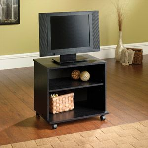 "Mainstays TV Cart for TVs up to 23-1/2"" Simple $20 tv stand on wheels, maybe add a curtain to the front to hide the video game clutter"