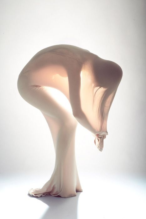 20-11-11 - Nylon translucent garment. Reminiscent of the birthing process. The garments translucency and the body's form creates the illusion that the garment is made from liquid