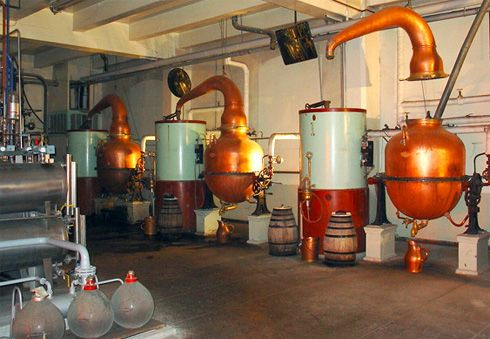 Contemporary set up of small copper pot stills at the Chartreuse distillery in France