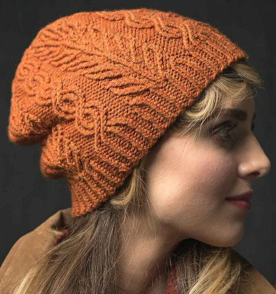 Knitting Pattern for Tree Boughs & Trails Hat - An unusual leaf stitch pattern hints at branches of trees; a clever cable variation suggests trails that meander through the woods. Three sizes. #ad One of the 22 patterns in Interweave Knits Holiday 2017. Click on pin image to see more and download the magazine.