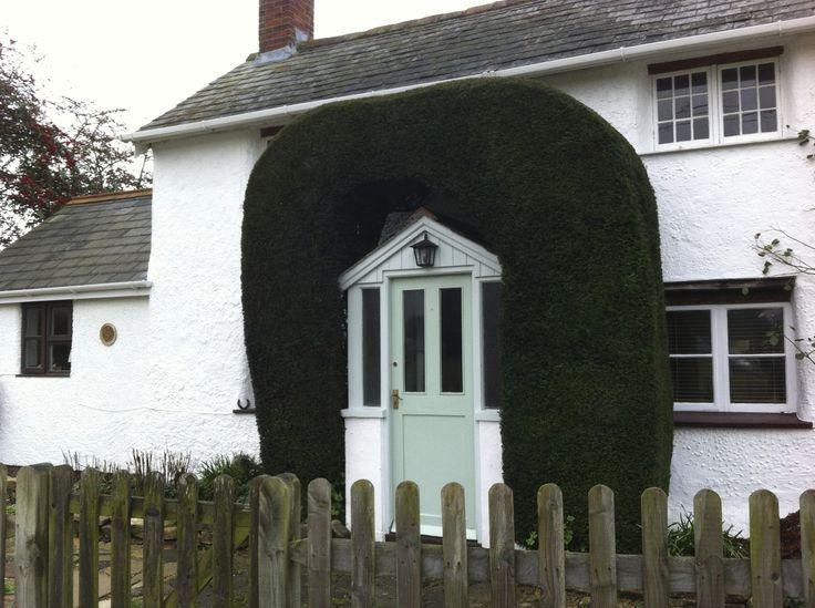 the evergreen border makes this door special.   Brockenhurst, UK