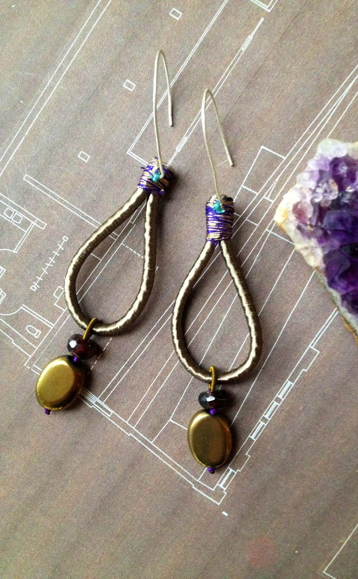 Gold Hematite & Ruby Agate on HandDesigned and HandMade 925 Silver Earrings with Free Style Purple & Gold Stitch on Olive Silk.   Inspired by Oriental Flowers, Urban Concrete, Tropical Monsoons and Fine Tea.   https://www.etsy.com/listing/213834459/olive-silk-gold-hematite-hand-made?ref=shop_home_active_1