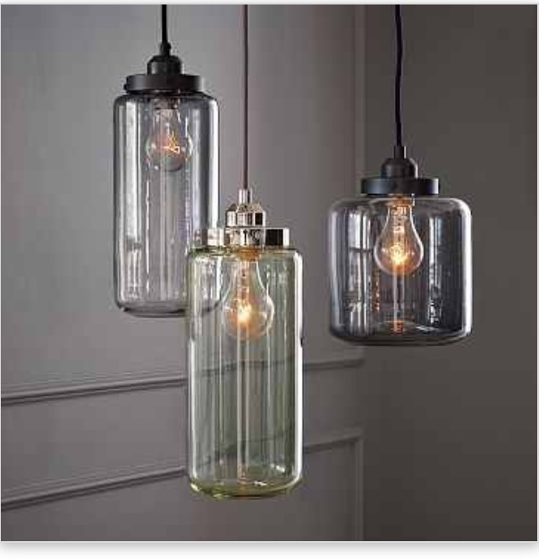 Glass Jar Pendants - to place over dining table. Antique glass jars inspired these softly glowing, industrial-chic pendant lights, which come in a palette that recalls the greens and grays of vintage bottles. Casting a cool glow over tables, counters and desks, these sculptural lamps work well as single pendants, but they're especially head-turning when hung in pairs or multiples at different heights.