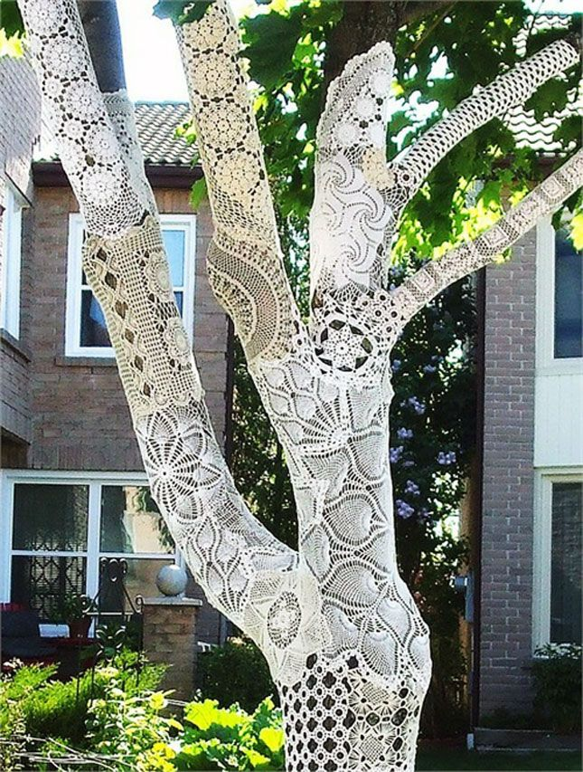 "White Crocheted Tree | 15 Yarn Bombs - I have mixed feelings about ""tree sweaters""...Love the whimsy and juxtaposition between nature and man-made craft, but I wonder if the poor tree feels like a dog in a sweater. Humiliated and uncomfortable?"