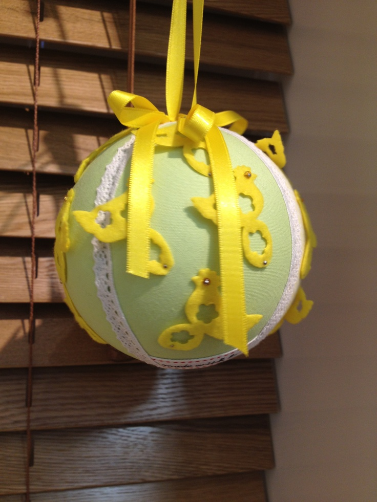 Polystyrene ball covered in fabric and embellished with chick ribbon.