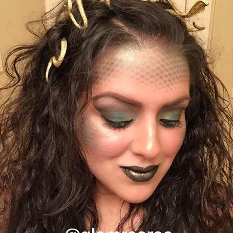 Medusa makeup  Product Breakdown: ➡️Dollar store snakes, spray painted gold, and secured with bobby pins. ➡️Scales were created with fishnets and colors from the @urbandecaycosmetics Vice palette in Blitz, Junkie, and Unhinged. ➡️Lip color is @katvondbeauty Everlasting Liquid Lipstick in Witches, with @benefitcosmetics Shimmer Powder in Mint Julep dusted on top. ➡️Blush is @narsissist in Sin. ➡️Highlight is @beccacosmetics x @jaclynhill Shimmering Skin Pe...