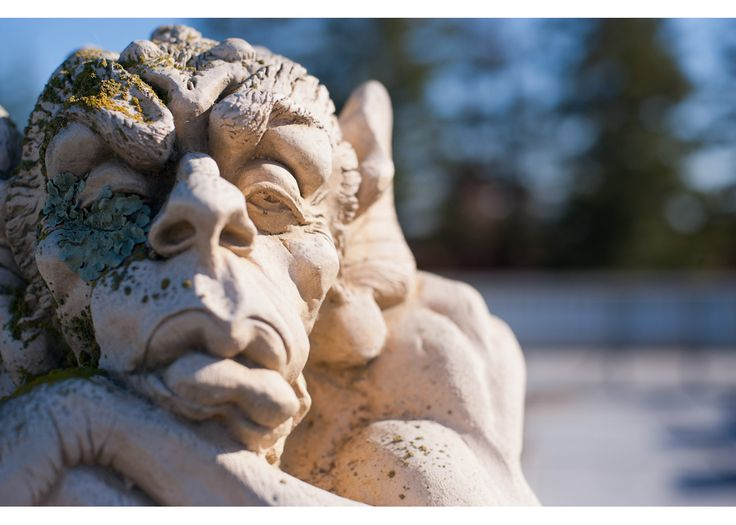 One of two gargoyles on the roof of Building 280B looks out with a stony expression. (Photo by Matt Beardsley)