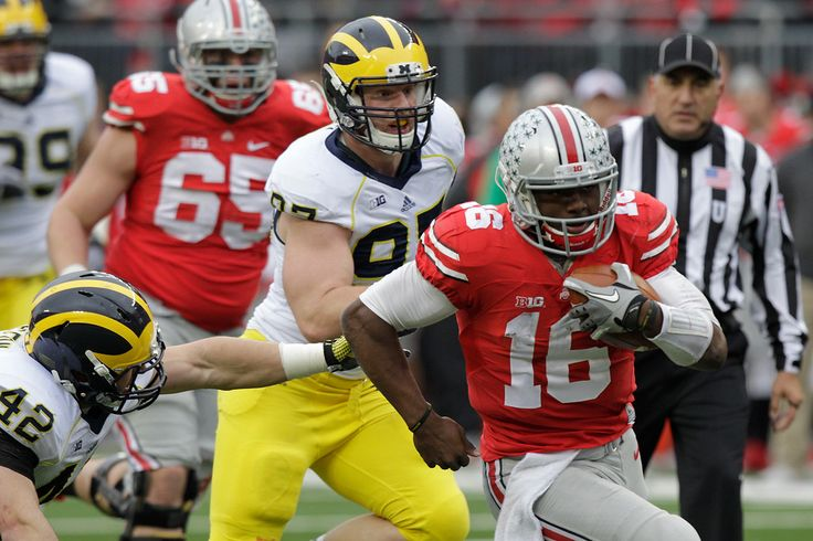 Description of . Ohio State quarterback J.T. Barrett plays against Michigan during an NCAA college football game Saturday, Nov. 29, 2014, in Columbus, Ohio. (AP Photo/Jay LaPrete)