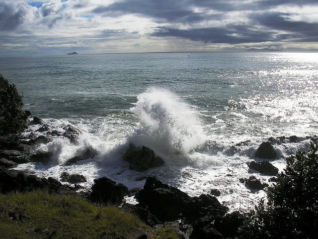 LocumLENS Finalist #5 Waves crash and clouds roll in Mount Maunganui, New Zealand. Photo courtesy of Dr. Karl Morgan.