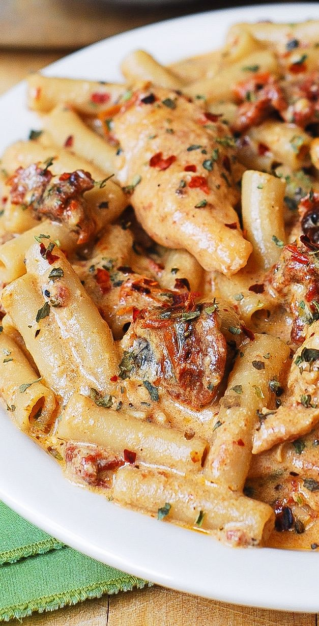 Creamy Chicken Mozzarella Pasta with Sun-Dried Tomatoes – Italian-inspired dinner with the best homemade creamy pasta sauce!  The sun-dried tomato pasta sauce is made from scratch using basil, red pepper flakes, garlic, paprika, cream, and shredded Mozzarella cheese. #creamy #chicken #chickenpasta #mozzarella #dinner #easydinner