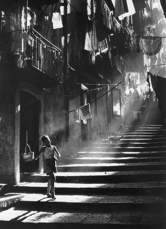 Napoli, Piergiorgio Branzi, 1953.   I love this photo.. singing, dancing, laughing..she's a little girl with nothing wrong and she's all alone..  I love it :)