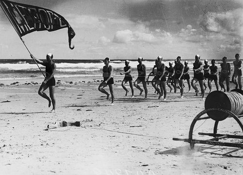 Metropolitan-Caloundra Surf Lifesavers marching in a parade on the beach at Caloundra, 1938 #vintage #beach #queensland #surflifesaving #caloundra #history #1930s
