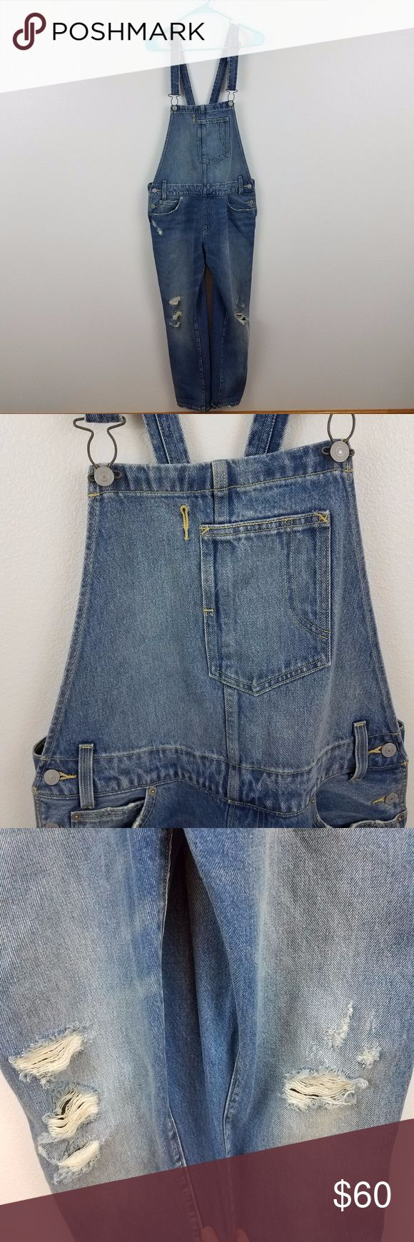 Levis overalls distressed jeans Levis overalls bibs dungarees medium wash distressed M pants jeans denim Size m, see measurements below. Used. No rips, tears, or stains. See photos.  Measurements are taken while item is lying flat.  Length: 58 inches  Waist (x2): 18.5 Inches  Inseam: 28 Inches  Inv BD. Levi's Jeans Overalls
