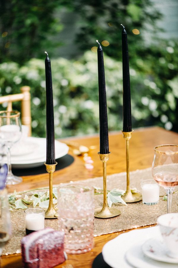 black taper candles, photo by Jessica Oh Photography http://ruffledblog.com/punk-rock-bridal-shower #weddingideas