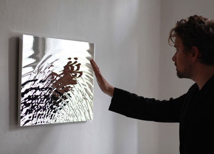 berlin-based studio fredrik skåtar has developed a 'vibration mirror'. the sculpture materializes a shape that constantly occurs in nature, however it cannot be seen because of perception of time and motion. in this project, the movement of water has been frozen and carved out as a sculpture to create a unique reflective composition