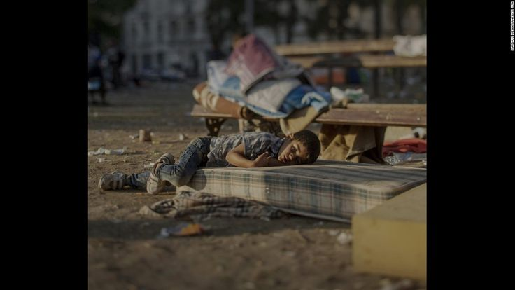Abdullah, 5, sleeps outside a railway station in Belgrade, Serbia. He saw the killing of his sister in their home in Daraa, Syria. He is still in shock and has nightmares every night, his mother says. Abdullah is tired and has a blood disease, but his mother does not have any money to buy medicine for him.