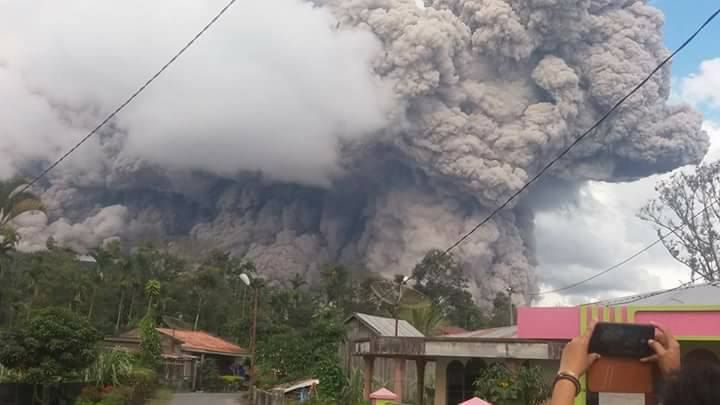 Sinabung volcano erupts spewing ash up to 4.6 kilometers into the sky and large pyroclastic flows hurtling down the flanks in pictures and videos