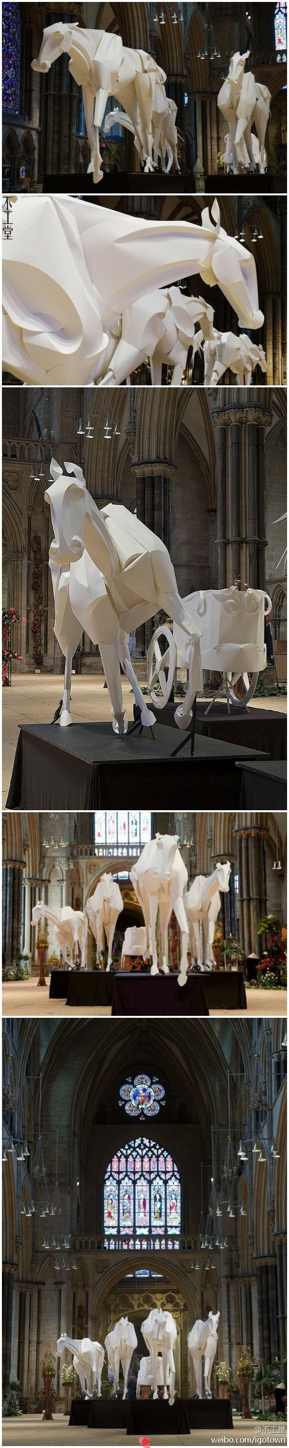 Installation by Richard Sweeney - horse and chariot sculpture installation made of paper inside the Lincoln Cathedral in Lincoln, England.
