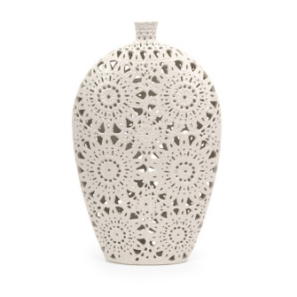 Hand carved lace patterned vase finished in a matte white.  19.5″h x 12″w x 3.25″d  www.lilahomedesigns.com