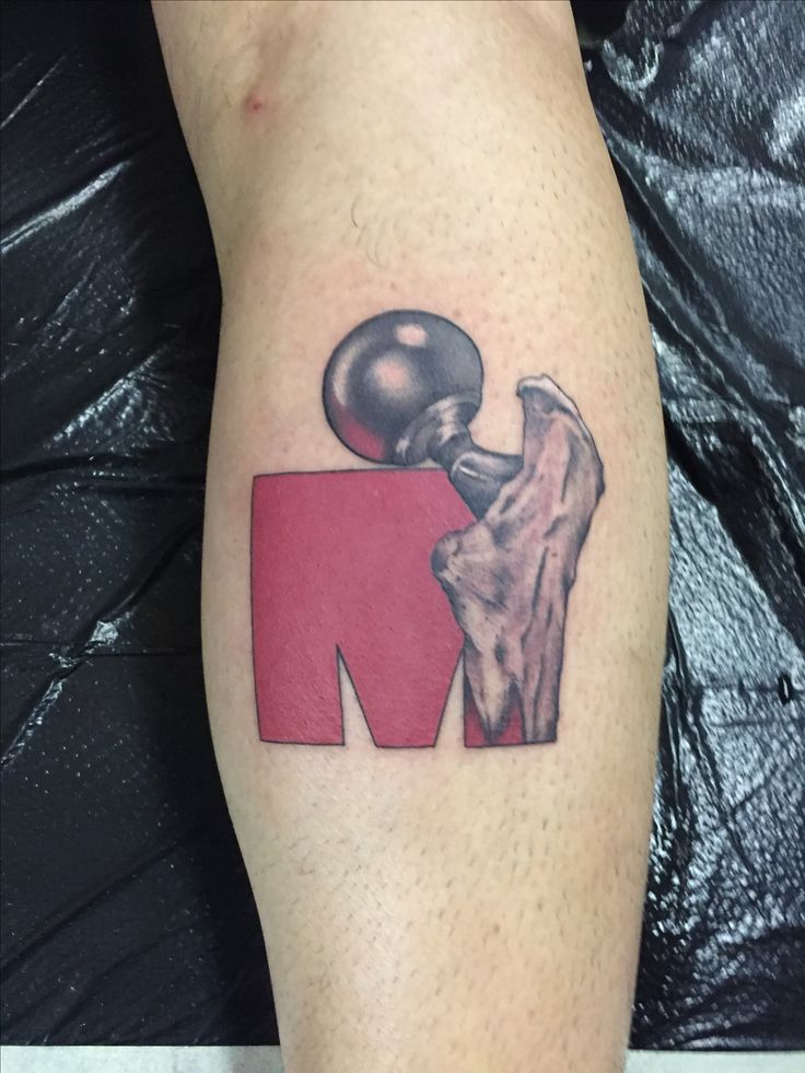 Ironman tattoo on orthopedic surgeon
