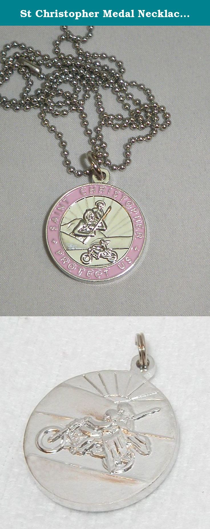 St Christopher Medal Necklace for Motorcycle Riders Pink w/ Stainless Steel Chain. The front of the medal shows St. Christopher (the protector of travel) keeping a watchful eye over the road delivering the rider safely to his destination.On the back of the medal, St. Christopher catches a ride on the bike of his faithful friend.