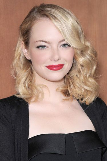 Side-swept curls - perfect for evening as Emma Stone shows hair style