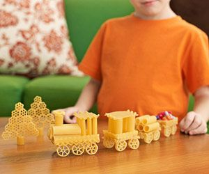 All Aboard!  A special treat for all our train game enthusiasts with children or just those young at heart... use leftover pasta bits for this DIY train as a toy!  Could also add some color by dying or painting the pasta!
