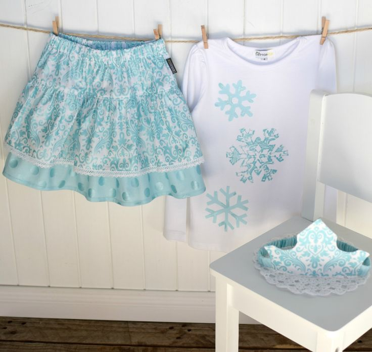 Special birthday party outfit for Scarlett. Hollywood sparkle double ruffle skirt with lace detail and matching snowflake applique top. Complimentary princess crown!