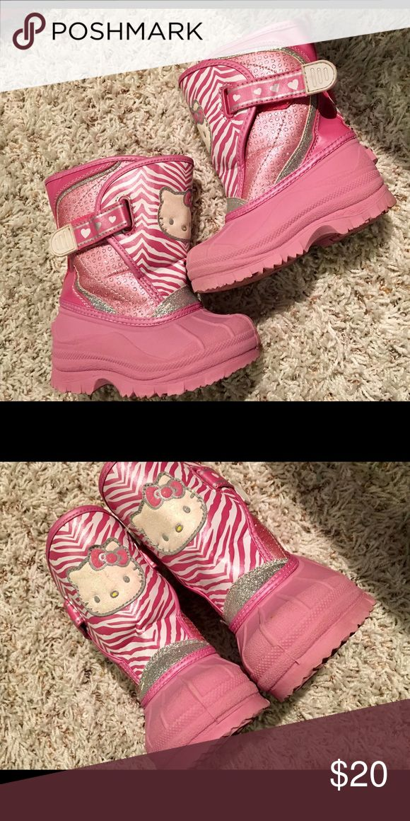 Hello Kitty snow boots Size M 7/8. Faux fur lining . Boot is pink with silver and pink glitter trimmings . Velcro fasteners on both sides. Hello kitty's face is glitter as well in a slightly off white color. So adorable! 💕🐱 Fast shipping! 📬📦‼️ ALSO HAVE IN A SIZE 9c !!! Sanrio Shoes Rain & Snow Boots