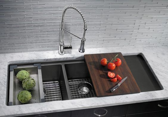double bowl sink with sliding chopping board, basket, drying rack, etc. LOVE the faucet!!!
