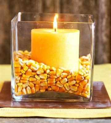 Super easy candle and corn fall decorating. More fall decorating ideas: http://www.midwestliving.com/homes/seasonal-decorating/easy-fall-decorating-projects/