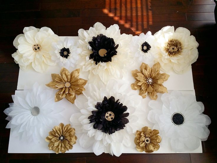 "Customize your own paper flower backdrop by choosing from a large selection of colors and our flower designs. Description: - Backdrop dimension is 30"" by 40"" - Mounted on a foam board for easy and lig"